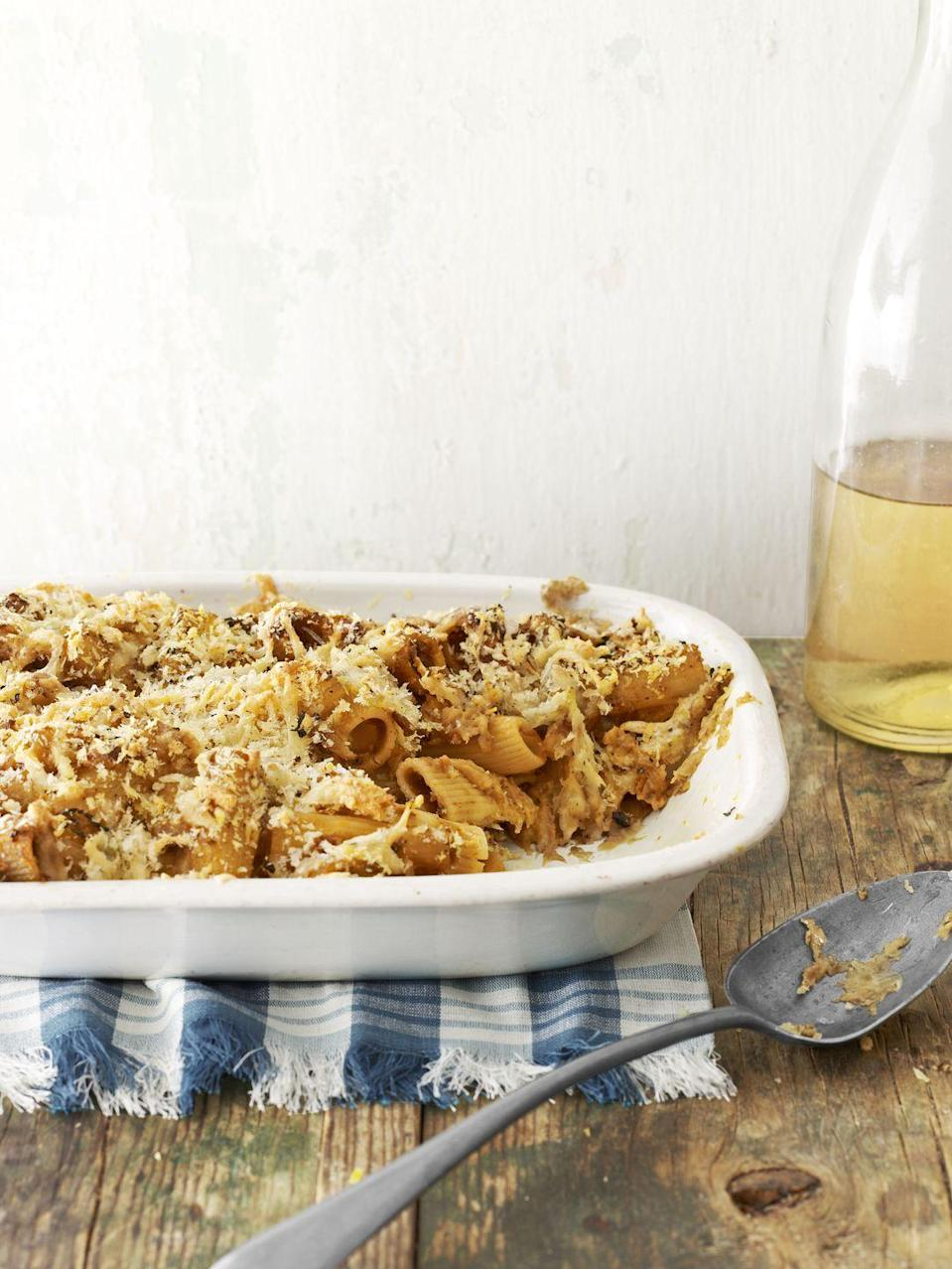 """<p>Sweet squash adds color and seasonal flavor to this creamy, cheesy pasta dish.</p><p><strong><a href=""""https://www.countryliving.com/food-drinks/recipes/a4139/baked-butternut-squash-rigatoni-recipe-clv0213/"""" rel=""""nofollow noopener"""" target=""""_blank"""" data-ylk=""""slk:Get the recipe."""" class=""""link rapid-noclick-resp"""">Get the recipe.</a></strong></p>"""