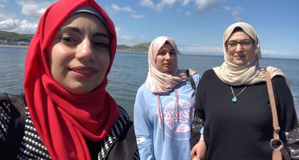 Hadir (left), pictured with her sister and mother, is currently working as a vaccinator and hopes to do a PhD in bioenergy (Hadir)