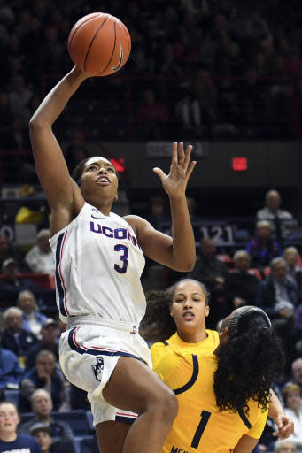 Connecticut's Megan Walker (3) goes up for two points in the first half of the team's NCAA college basketball game against California on Sunday, Nov. 10, 2019, in Storrs, Conn. (AP Photo/Stephen Dunn)