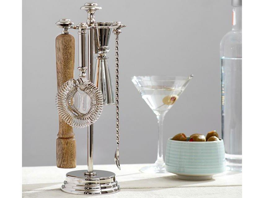 """<p>Rack up bar tools like a pro with this compact set including a jigger, strainer, bar spoon and a muddler all on a brass stand.</p> <p><em>Harrison Bar Tool Set, $69 at <a href=""""http://pottery-barn.7eer.net/c/249354/267848/4332?subId1=FW%2Ccocktail-gifts-harrison-bar-tool-set-FT-SS1117.jpg%2Cmsoll1271%2C%2CIMA%2C1258925%2C201907%2CI,FW&u=http%3A%2F%2Fwww.potterybarn.com%2Fproducts%2Fharrison-classic-metal-bar-tool-set%2F"""" target=""""_blank"""">Pottery Barn</a></em></p>"""