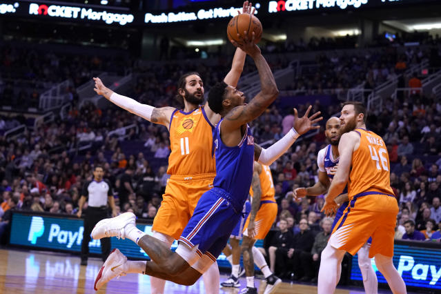 New York Knicks guard Elfrid Payton, front left, drives past Phoenix Suns guard Ricky Rubio (11) in the first half of an NBA basketball game, Friday, Jan. 3, 2020, in Phoenix. (AP Photo/Rick Scuteri)
