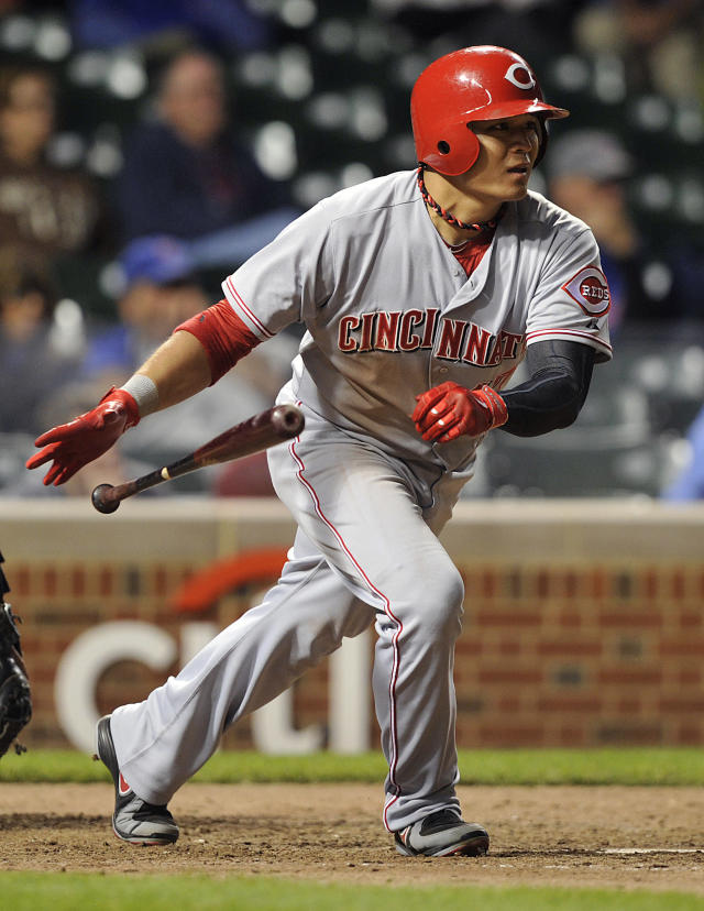Cincinnati Reds' Shin-Soo Choo singles in two runs against the Chicago Cubs during the 11th inning of a baseball game Tuesday, Aug. 13, 2013, in Chicago. (AP Photo/Jim Prisching)