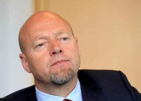 FILE PHOTO: Norway's SWF fund CEO Slyngstad listens during an interview in Oslo