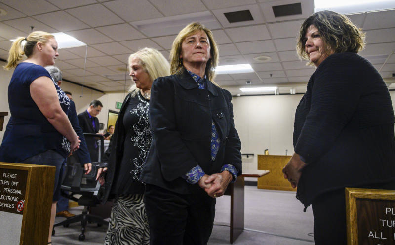 "Guiding Hands School special education teacher Kimberly Wohlwend, far left, accused of restraining 13-year-old Max Benson, principal Staranne Meyers, center, and site administrator Cindy Keller, right, are arraigned on involuntary manslaughter charges in El Dorado Superior Court, Wednesday, Nov. 13, 2019, in Placerville, Calif. Max, who was autistic, died a day after he was put into a ""prone restraint"" for nearly two hours by his special education teacher and school staff. (Daniel Kim/The Sacramento Bee via AP)"