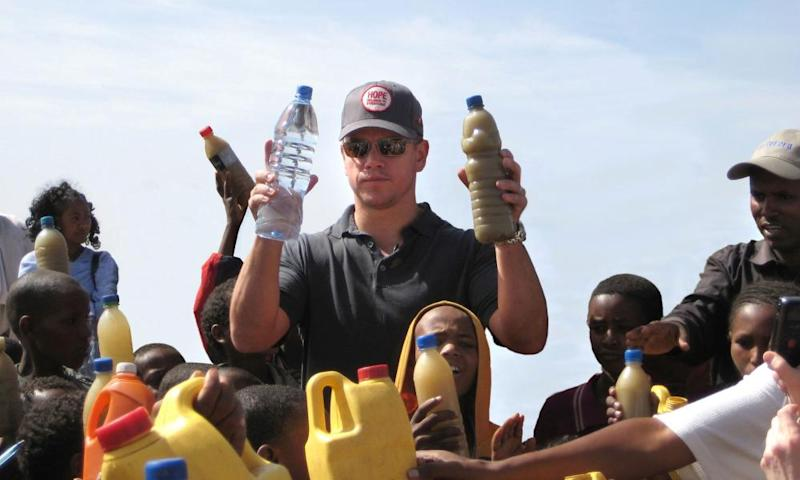 Matt Damon visits a well just outside Mekele, Ethiopia, in 2009. In his right hand he holds a bottle of regular water, in his left is a bottle of dirty water local children in Mekele drink every day