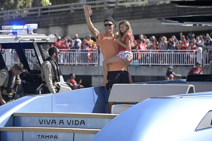 Tom Brady with daughter Vivian Lake on a boat.