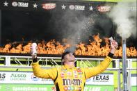 Kyle Busch celebrates in Victory Lane after winning a NASCAR Xfinity Series auto race at Texas Motor Speedway in Fort Worth, Texas, Saturday, June 12, 2021. (AP Photo/Larry Papke)