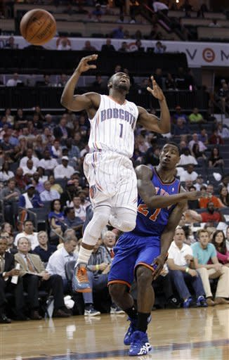 Charlotte Bobcats' Kemba Walker (1) reacts as he is fouled by New York Knicks' Iman Shumpert (21) during the first half of an NBA basketball game in Charlotte, N.C., Thursday, April 26, 2012. (AP Photo/Chuck Burton)