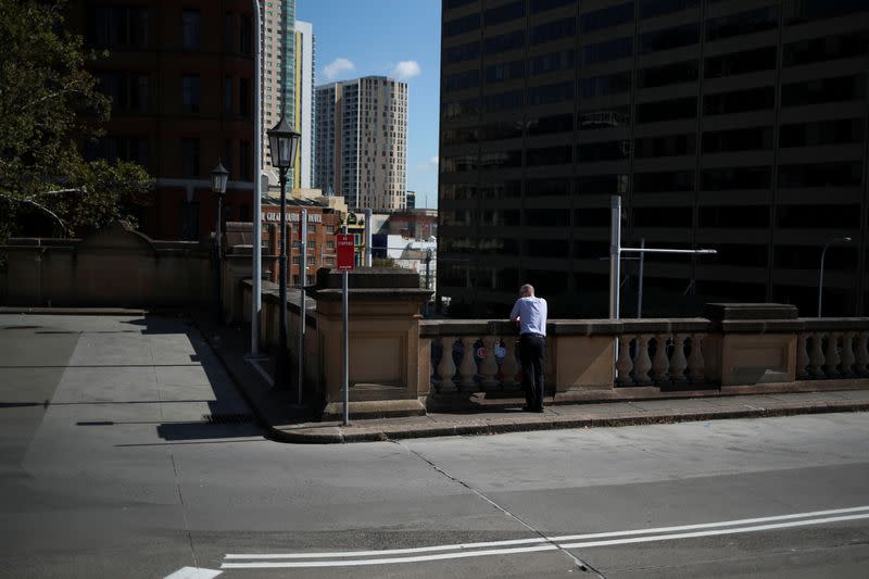 A man takes a break at Sydney Central railway station during a workday following the implementation of stricter social-distancing and self-isolation rules to limit the spread of the coronavirus disease (COVID-19) in Sydney