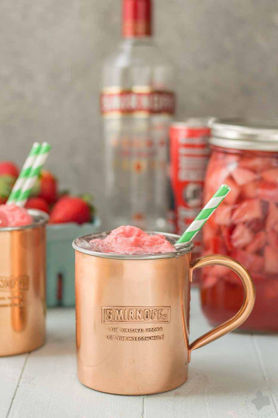 "<p>I<strong>ngredients</strong>:<br></p><p>1.5 oz. Smirnoff Vodka</p><p>1 Lime</p><p>4 oz. Ginger Beer</p><p>Ice</p><p>Scoop of Strawberry Sorbet</p><p><strong>Directions</strong>: </p><p>Into the bottom of a copper mug, add vodka, lime juice, and ice. Top with ginger beer and a scoop of sorbet.</p><p><em>Created by Megan Marlowe of <a href=""http://www.strawberryblondiekitchen.com/"" rel=""nofollow noopener"" target=""_blank"" data-ylk=""slk:Strawberry Blondie Kitchen"" class=""link rapid-noclick-resp"">Strawberry Blondie Kitchen</a></em></p>"