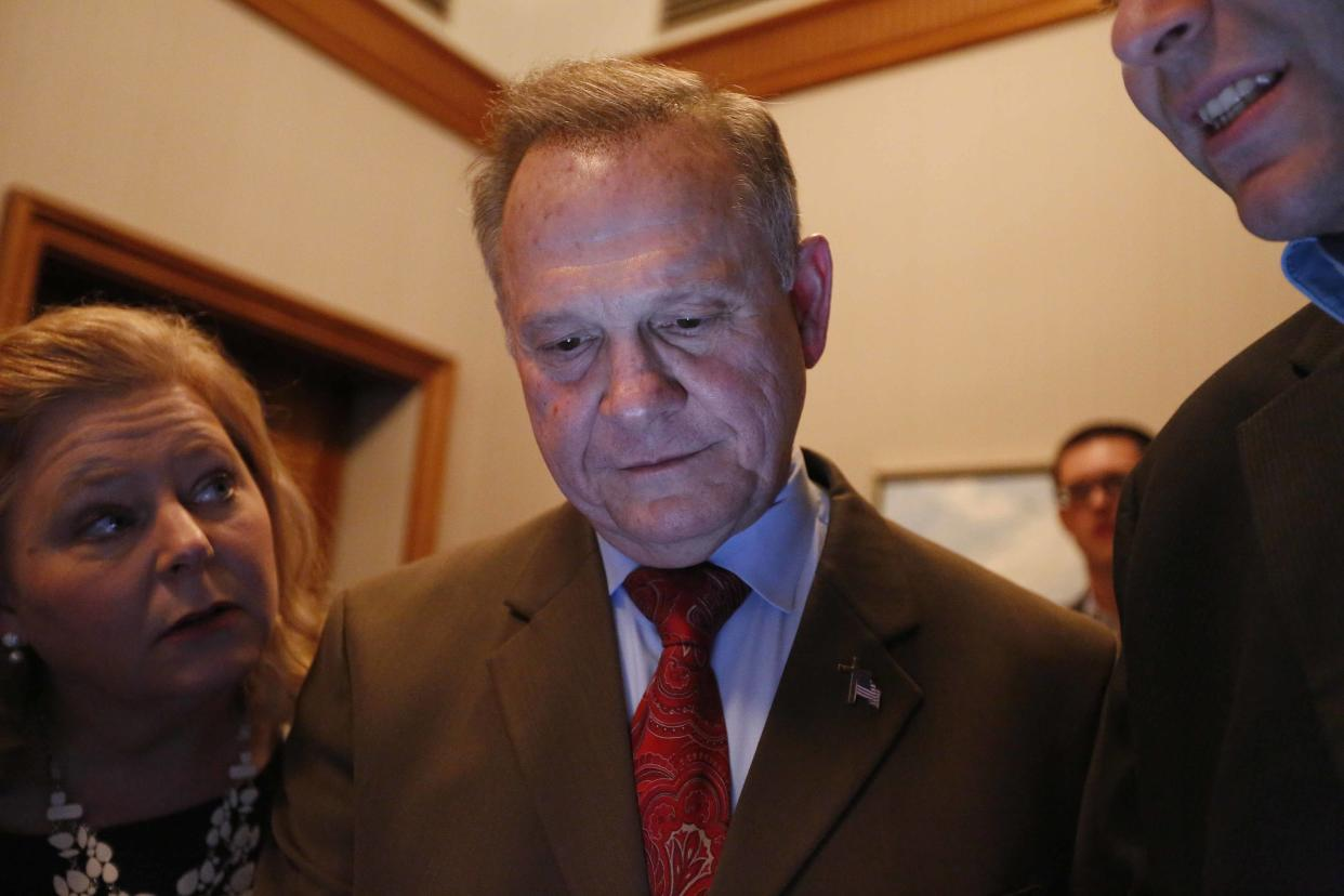Republican Senate candidate Roy Moore looks at election returns with staff during an election-night watch party in Montgomery, Ala., on Tuesday. (Photo: Brynn Anderson/AP)