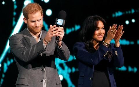 """The Duke and Duchess of Sussex applaud an audience of """"inspiring"""" young people - Credit: Reuters"""