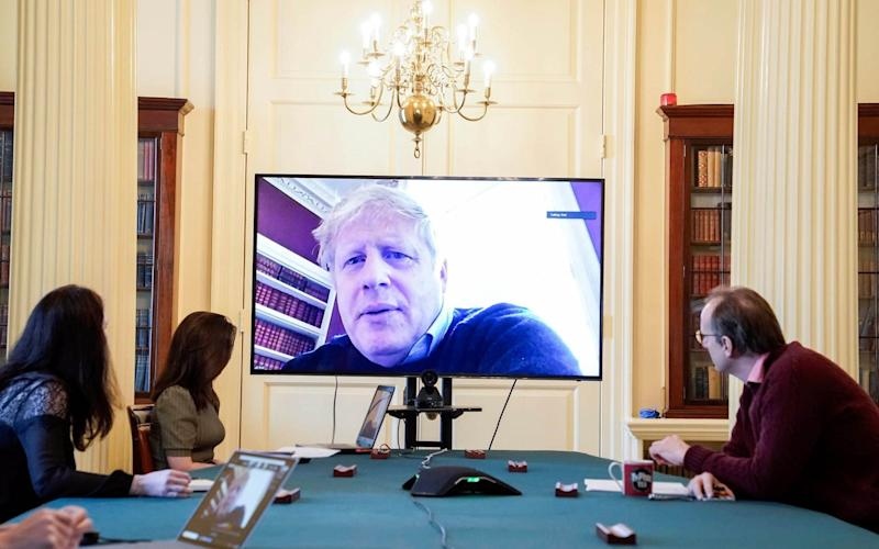 Boris Johnson leading the government and taking Cabinet meetings via a Zoom video call - UNPIXS (Europe)