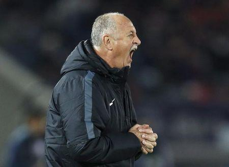 Guangzhou Evergrande's head coach Scolari directs his players during their Club World Cup third-place soccer match against Japan's Sanfrecce Hiroshima in Yokohama