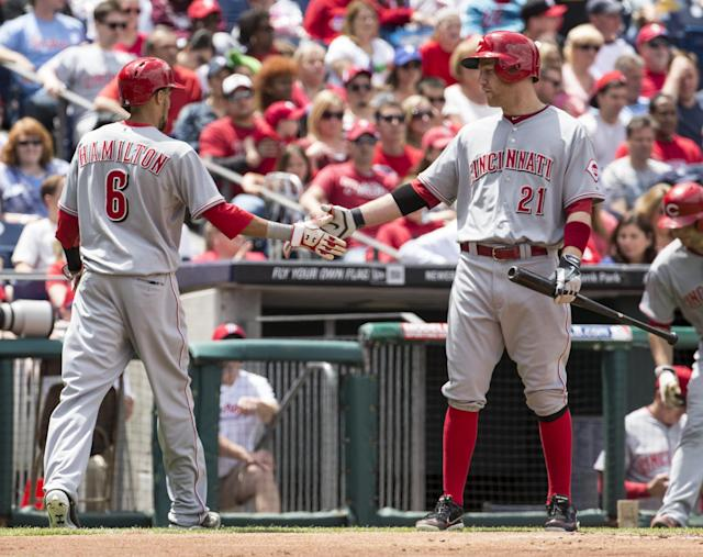 Cincinnati Reds' Billy Hamilton, left, celebrates scoring with teammate Todd Frazier, right, during the first inning of a baseball game against the Philadelphia Phillies, Sunday, May 18, 2014, in Philadelphia. (AP Photo/Chris Szagola)