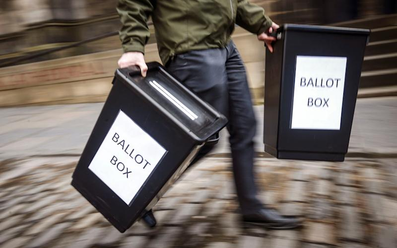 Ballot boxes are carried in Edinburgh - Credit: Danny Lawson/PA