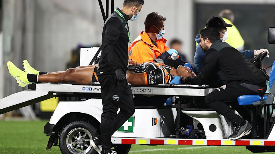 Michael Chee-Kam, pictured here being stretchered off the field.