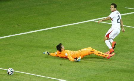 Costa Rica's Urena scores a goal next to Uruguay's goalkeeper Muslera during their 2014 World Cup Group D soccer match at the Castelao arena in Fortaleza