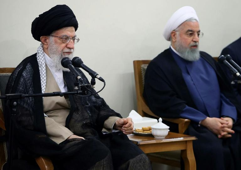 "Iran's supreme leader Ayatollah Ali Khamenei (L) has protected President Hassan Rouhani from being impeached by parliament like two of his key ministers, calling on lawmakers to work ""day and night"" to resolve the country's economic problems"