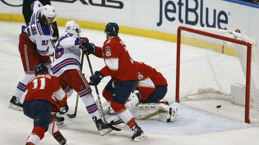 New York Rangers center Mika Zibanejad (93) shoots and scores against Florida Panthers goaltender Roberto Luongo (1) during the first period of an NHL hockey game, Saturday, Dec. 8, 2018, in Sunrise, Fla. (AP Photo/Brynn Anderson)