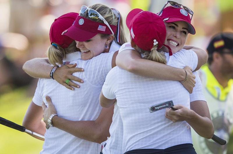US golfers (L-R) Stacy Lewis, Lexi Thompson, Cristie Kerr and Paula Creamer hug after winning their matches during the second round of the LGPA International Crown at Caves Valley Golf Club in Owings Mills, Maryland, on July 25, 2014 (AFP Photo/Jim Watson)