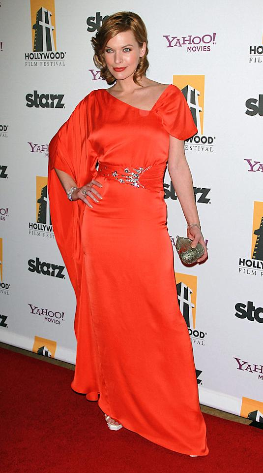 "Can you tell Milla Jovovich loves her Temperley London dress? The ""Resident Evil"" babe looks like a million dollars in her bright orange draped gown. David Livingston/<a href=""http://www.gettyimages.com/"" target=""new"">GettyImages.com</a> - October 25, 2010"