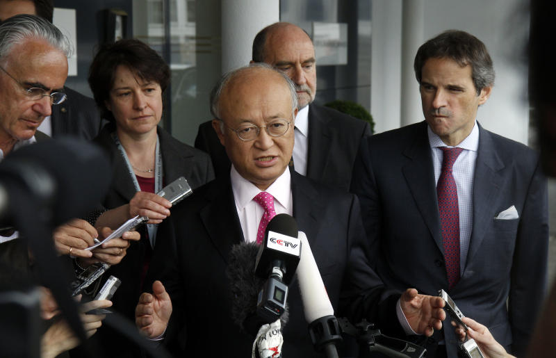 "Director General of the International Atomic Energy Agency, IAEA, Yukiya Amano, center, from Japan speaks to the media after returning from Iran at the Vienna International Airport near Schwechat, Austria, on Tuesday, May 22, 2012. Amano says he has reached a deal with Iran on probing suspected work on nuclear weapons and adds that the agreement will ""be signed quite soon."" (AP Photo/Ronald Zak)"