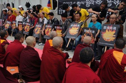 Tibetans display portraits of people who killed themselves in China during a protest in front of the Liberty Square in Taipei. Some 60 Tibetans living in Taiwan held a 12-hour hunger strike demonstration to call for the international societies to support the independence of Tibet