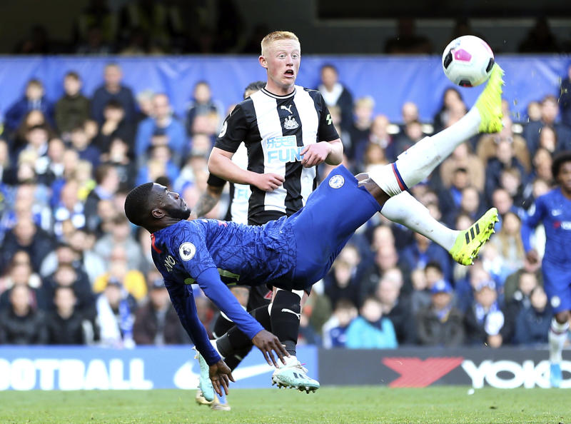 Chelsea's Tammy Abraham attempts an overhead kick during the British Premier League soccer match between Newcastle United and Chelsea, at Stamford Bridge, London, Saturday, Oct. 19, 2019. (Steven Paston/PA via AP)