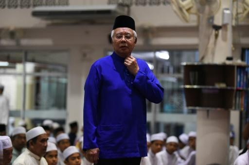 Malaysia's ruling coalition takes slight lead in election count