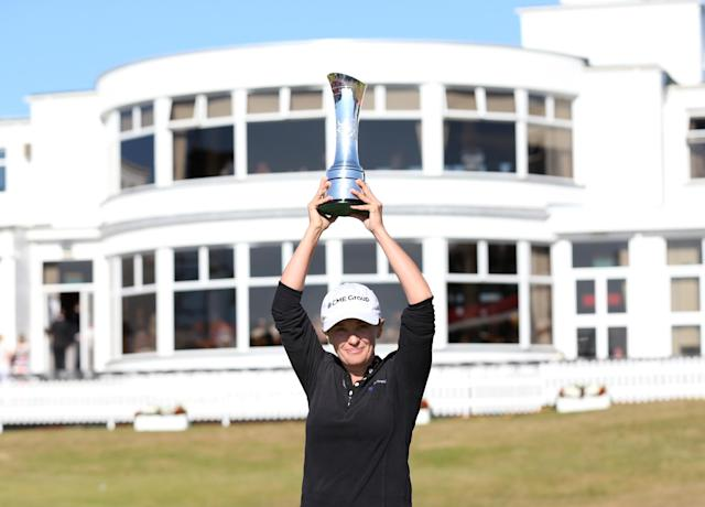 Mo Martin of the U.S poses with the trophy after winning the Women's British Open golf championship at the Royal Birkdale Golf Club, in Southport, England, Sunday, July 13, 2014. (AP Photo/Scott Heppell)