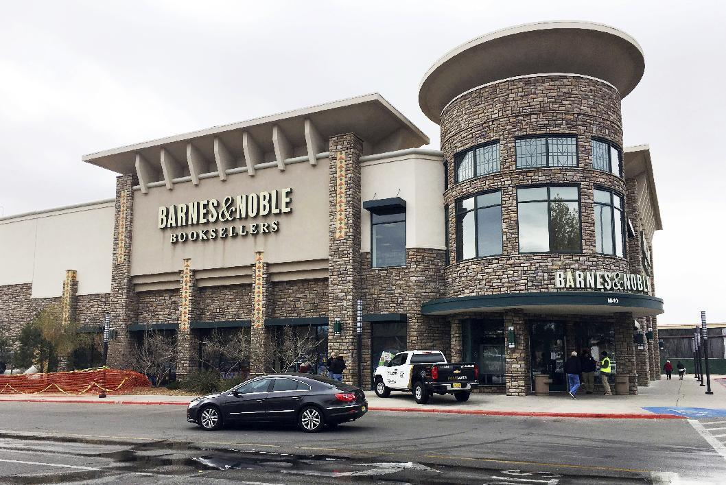 Workers clean up a Barnes & Noble store in Albuquerque, N.M. on Monday, Nov. 28, 2016, two days after authorities say an explosive device damaged the store. Federal authorities charged a man on Monday with using an explosive device to damage the store, where a string of local, overnight fires and instances of vandalism during the busiest shopping weekend of the year also damaged three Starbucks shops, a Barnes & Noble and other establishments in New Mexico's largest city. (AP Photo/Russell Contreras)