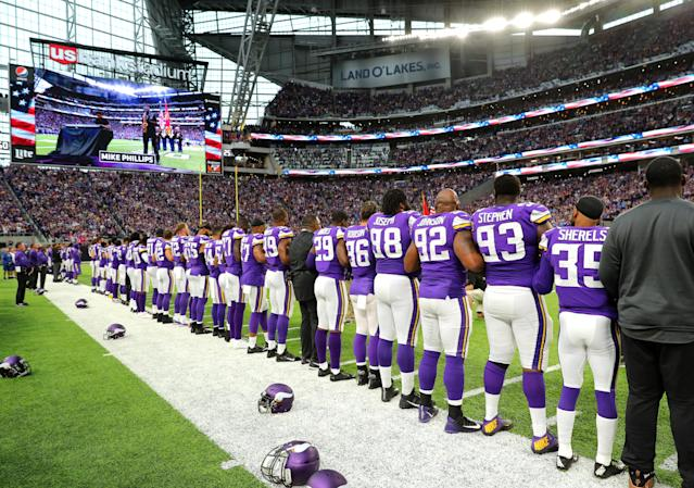 <p>Minnesota Vikings players link arms during the national anthem before the game against the Detroit Lions on October 1, 2017 at U.S. Bank Stadium in Minneapolis, Minnesota. (Photo by Adam Bettcher/Getty Images) </p>