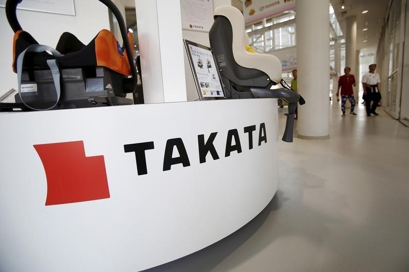 A logo of Takata Corp is seen with its display at a showroom for vehicles in Tokyo