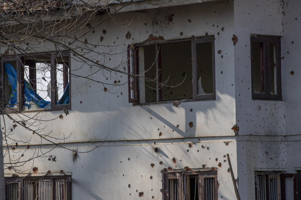 Bullet marks cover the wall of a building where suspected militants had taken refuge, after a gun battle on the outskirts of Srinagar, Indian controlled Kashmir, Wednesday, Dec. 30, 2020. A gun battle between rebels and government forces overnight killed three rebels on the outskirts of Srinagar on Wednesday, officials said. (AP Photo/ Dar Yasin)