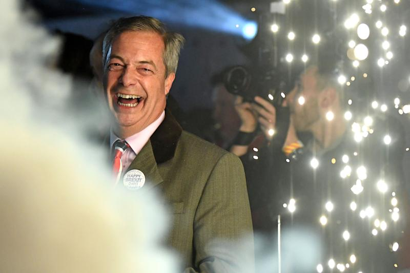 Brexit Party leader Nigel Farage smiles on stage in Parliament Square, venue for the Leave Means Leave Brexit Celebration as 11 O'Clock passes, in central London on January 31, 2020, the moment that the UK formally left the European Union. - Brexit supporters gathered outside parliament on Friday to cheer Britain's departure from the European Union following three years of epic political drama -- but for others there were only tears. After 47 years in the European fold, the country leaves the EU at 11:00pm (2300 GMT) on Friday, with a handful of the most enthusiastic supporters gathering opposite the Houses of Parliament 12 hours before the final countdown. (Photo by DANIEL LEAL-OLIVAS / AFP) (Photo by DANIEL LEAL-OLIVAS/AFP via Getty Images)