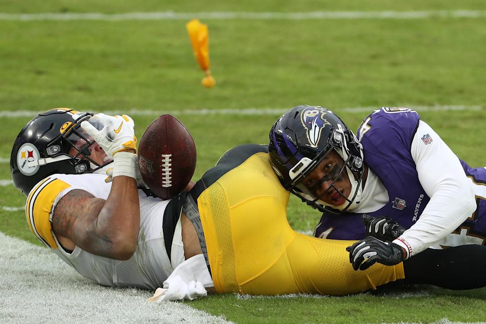 Cornerback Marlon Humphrey tackles Steelers wide receiver Chase Claypool.