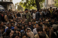 Afghans wait in front of a bank branch as they try to withdraw money in Kabul, Afghanistan, Sunday, Sept. 12, 2021. (AP Photo/Bernat Armangue)