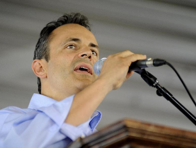 FILE - In this Aug. 3, 2013 file photo, Louisville businessman Matt Bevin, the Senate primary election opponent of Senate Minority Leader Mitch McConnell of Ky. speaks in in Fancy Farm, Ky. In the midst of a double-barreled re-election fight,McConnell is earning praise back home _ and from some of the most unlikely of corners _ for brokering of the deal that ended the partial government shutdown and averted a potential default on U.S. debt. (AP Photo/Stephen Lance Dennee)
