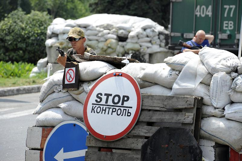 Pro-Russian separatists stand guard at their check-point near the eastern Ukrainian city of Donetsk on July 23, 2014 (AFP Photo/Alexander Khudoteply)