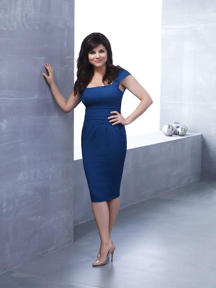 "Tiffani Thiessen stars as Elizabeth Burke in ""White Collar."""