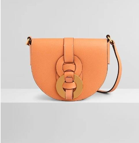 <p>The <span>Chloé Darryl saddle bag</span> ($1,250) is the perfect small crossbody to wear over dresses and blazers.</p>