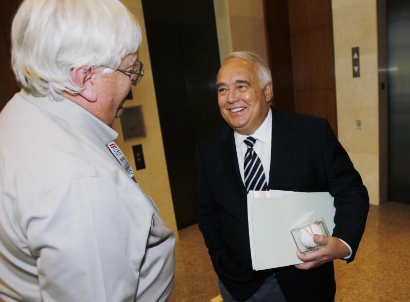 Ron Fowler, right, jokes with a reporter after the announcement of the approval of the sale of the San Diego Padres to a ownership group headed by Fowler and members of the O'Malley family of Los Angeles Dodgers fame during a meeting of baseball owners in Denver on Thursday, Aug. 16, 2012. Fowler, the chief executive of Liquid Investments, will become the controlling owner of the franchise if the purchase price of around $800 million is accepted by current Padres owner John Moores. (AP Photo/David Zalubowski)