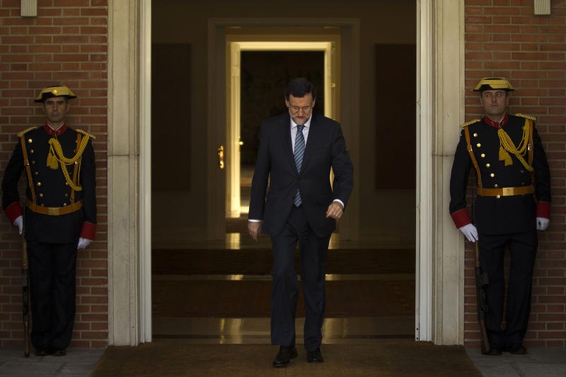 Spain's Prime Minister Mariano Rajoy walks to welcome Romania's Prime Minister Victor Ponta, not seen, before a meeting at the Moncloa Palace, in Madrid, Monday, July 22, 2013. Opposition leaders called for Rajoy to explain himself before Parliament or face a censure vote. Rajoy brushed off demands he should resign after text messages emerged showing him comforting a former political party treasurer under investigation over a slush fund and secret Swiss bank accounts. The treasurer has claimed Rajoy took under-the-counter payments, accusations denied by Rajoy. (AP Photo/Daniel Ochoa de Olza)