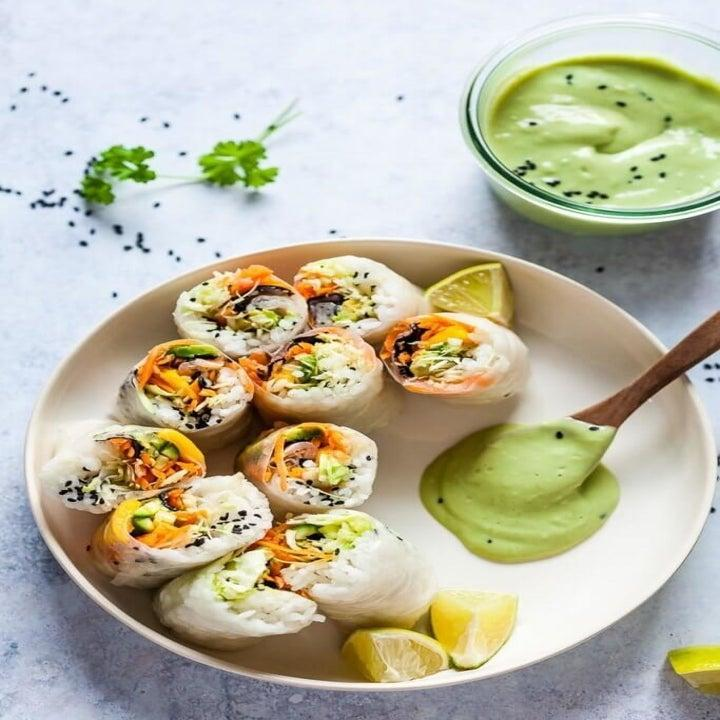Vegetarian spring rolls with avocado dipping sauce.