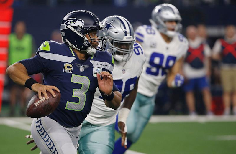Seattle Seahawks quarterback Russell Wilson runs out of the pocket against the Dallas Cowboys during the first half of the NFC wild-card NFL football game in Arlington Texas Saturday Jan. 5 2019
