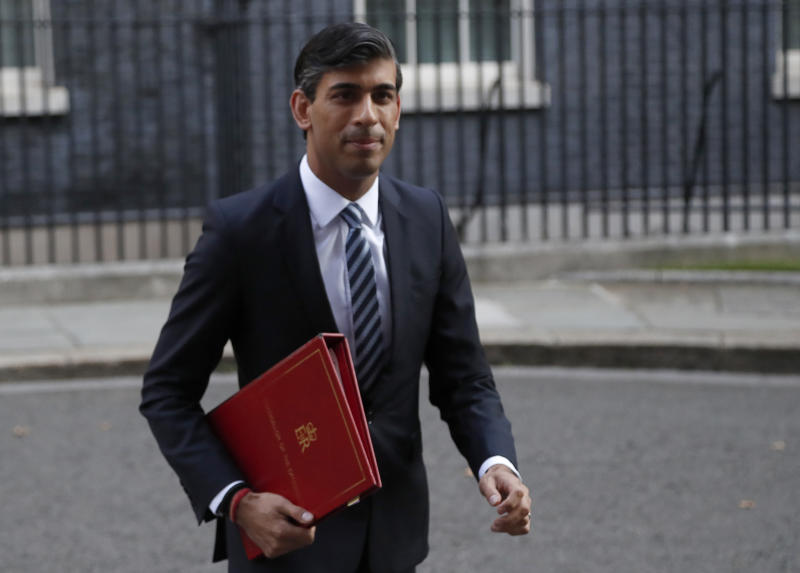 Chancellor of the Exchequer Rishi Sunak walks across Downing Street to a cabinet meeting in London, Tuesday, Sept. 15, 2020.(AP Photo/Frank Augstein)