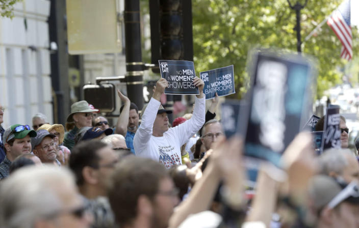 <p>Supporters rally outside the North Carolina State Capitol in Raleigh on April 11, 2016, in support of a law that blocks rules allowing transgender people to use public bathrooms aligned with their gender identity. <i>(Gerry Broome/AP)</i></p>