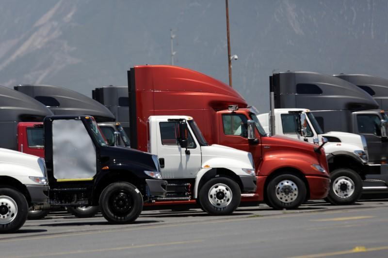 Trucks are parked at a yard of the manufacturing plant of International brand commercial trucks, owned by Navistar, in Escobedo