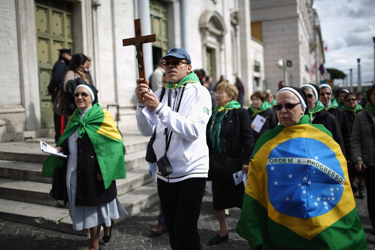 ROME, ITALY - MARCH 10:  Brazilian Catholic nuns and pilgrims take part in a procession to St Peter's Basilica on March 10, 2013 in Rome, Italy. Cardinals are set to enter the conclave to elect a successor to Pope Benedict XVI after he became the first pope in 600 years to resign from the role. The conclave is scheduled to start on March 12 inside the Sistine Chapel and will be attended by 115 cardinals as they vote to select the 266th Pope of the Catholic Church.  (Photo by Christopher Furlong/Getty Images)